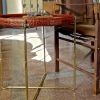 safari wine table by chair - cognac color